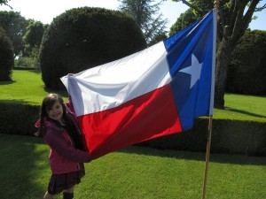 Amelia with the Texas flag